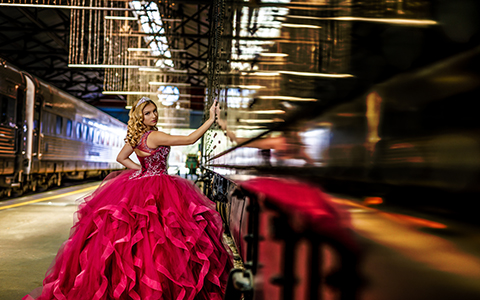 Quinceanera photography on on train, red dress, Morilee