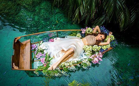 Quinceanera photography with canoe in Secret Garden